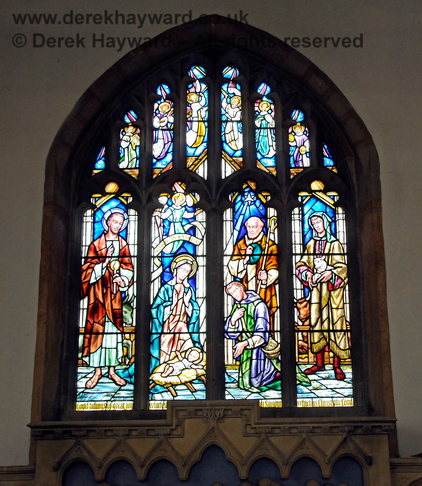 """The east window above the Altar depicting the Nativity.  The inscription at the base of the window reads, """"Good tidings of great joy which is a Saviour which is Christ the Lord"""".  St Botolphs Church, Chevening.  19.06.2015  12836"""