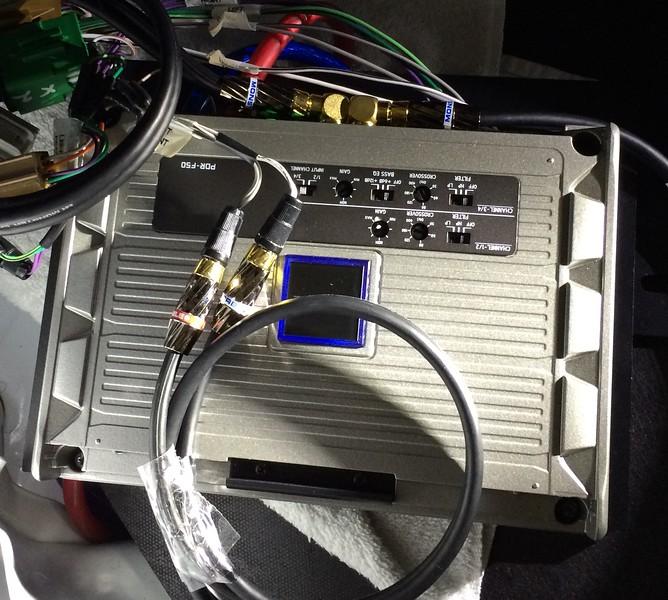 """Aftermarket amplifier mounted on PVC amplifier mounting board from  <a href=""""http://www.car-speaker-adapters.com"""">http://www.car-speaker-adapters.com</a>"""