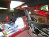 "Remove Rear Pillar ""Side"" Trim Panel<br /> Pry out retainer strap (black clip) then pull toward front of vehicle to remove."