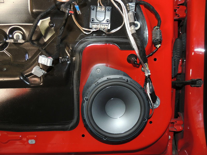 """Aftermarket speaker and speaker adapter from  <a href=""""http://www.car-speaker-adapters.com/items.php?id=SAK075""""> Car-Speaker-Adapters.com</a>  installed on door"""