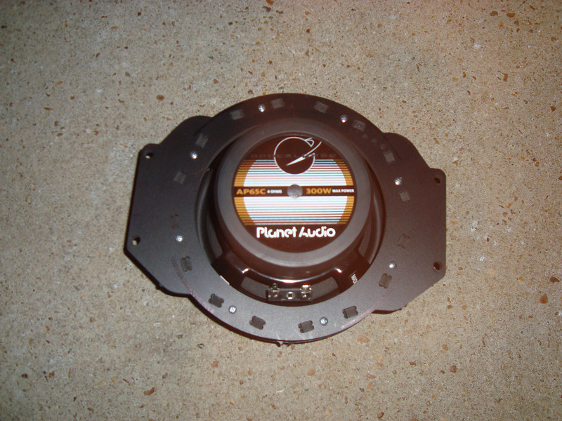 """Rear view of aftermarket speaker mounted to speaker adapter from  <a href=""""http://www.car-speaker-adapters.com/items.php?id=SAK055""""> Car-Speaker-Adapters.com</a>"""