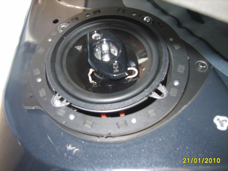 """Aftermarket speaker and speaker adapter from  <a href=""""http://www.car-speaker-adapters.com/items.php?id=SAK062""""> Car-Speaker-Adapters.com</a>  installed in door"""