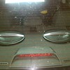 View of aftermarket speakers through rear windows