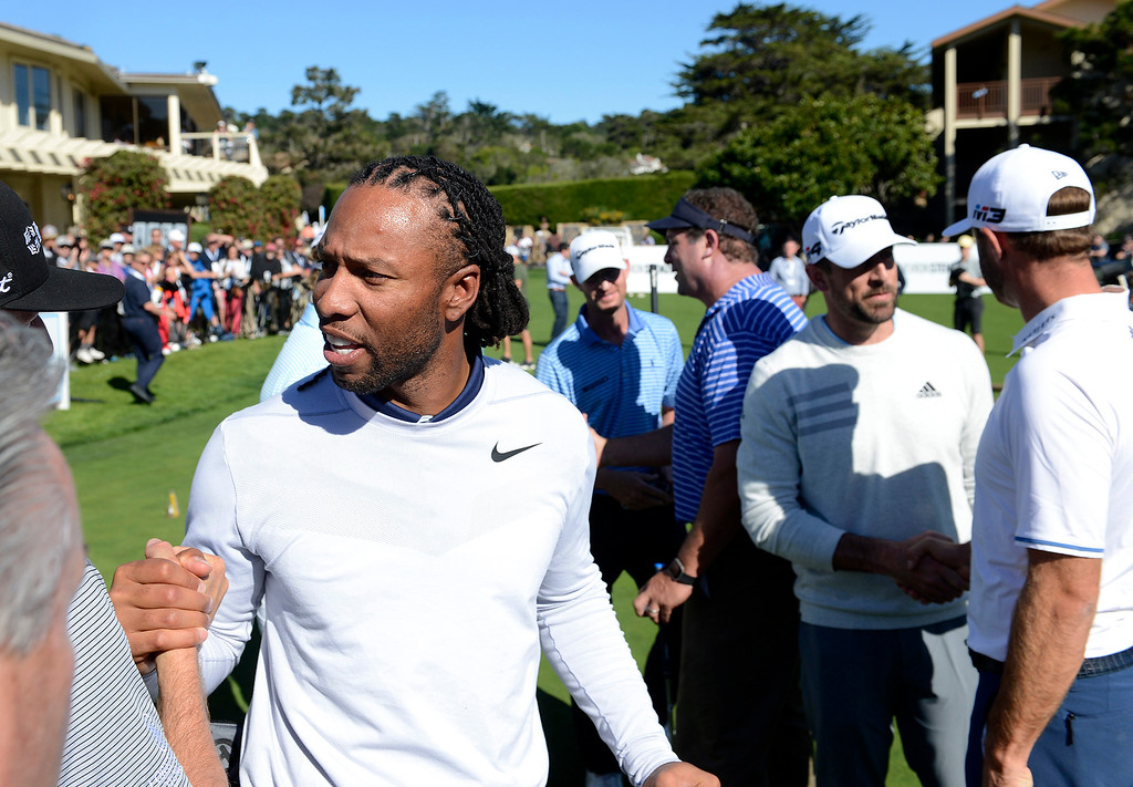 . Larry Fitzgerald from the NFLs Arizona Cardinals in the Chevron Shoot-Out at the Pebble Beach Golf Links practice green on Tuesday, Feb. 6, 2018.  The Chevron Shoot-Out is a two-person teams that faced off in a five-hole putting challenge for charity. Teams were made by pairing past tournament champions with champions from other sports.  (Vern Fisher - Monterey Herald)