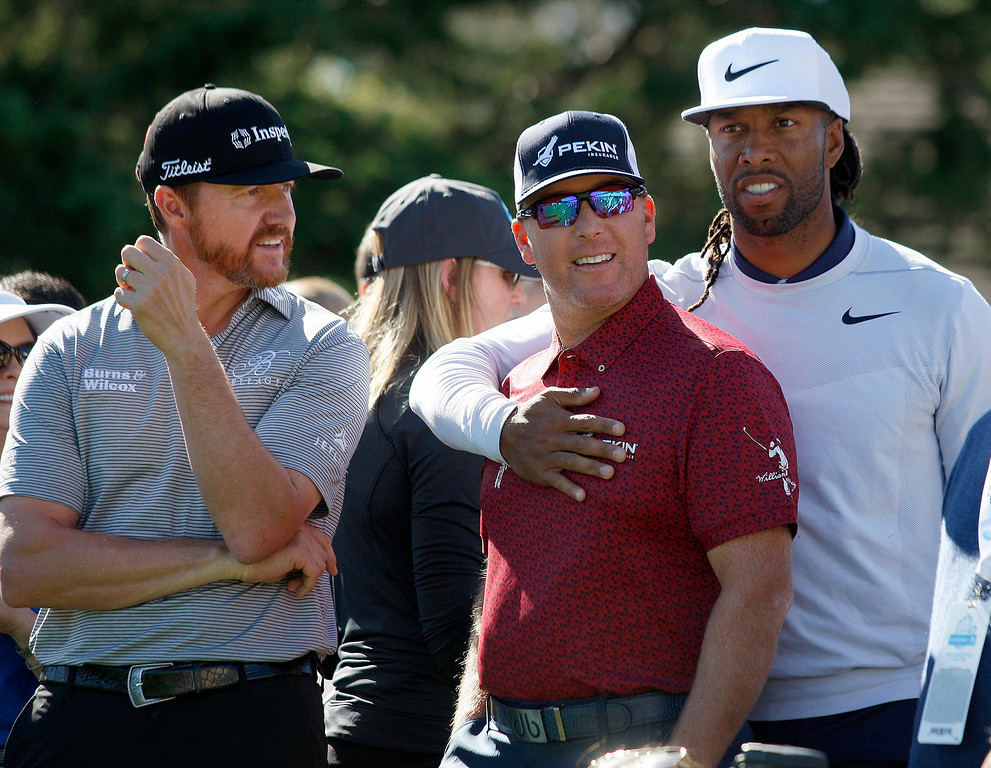. PGA pro Jimmy Walker and D.A. Points with Larry Fitzgerald from the Arizona Cardinals in the Chevron Shoot-Out at the Pebble Beach Golf Links practice green on Tuesday, Feb. 6, 2018.  The Chevron Shoot-Out is a two-person teams that faced off in a five-hole putting challenge for charity. Teams were made by pairing past tournament champions with champions from other sports.  (Vern Fisher - Monterey Herald)