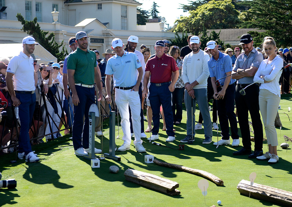 . Contestants in the Chevron Shoot-Out at the Pebble Beach Golf Links practice green on Tuesday, Feb. 6, 2018.  The Chevron Shoot-Out is a two-person teams that faced off in a five-hole putting challenge for charity. Teams were made by pairing past tournament champions with champions from other sports.  (Vern Fisher - Monterey Herald)