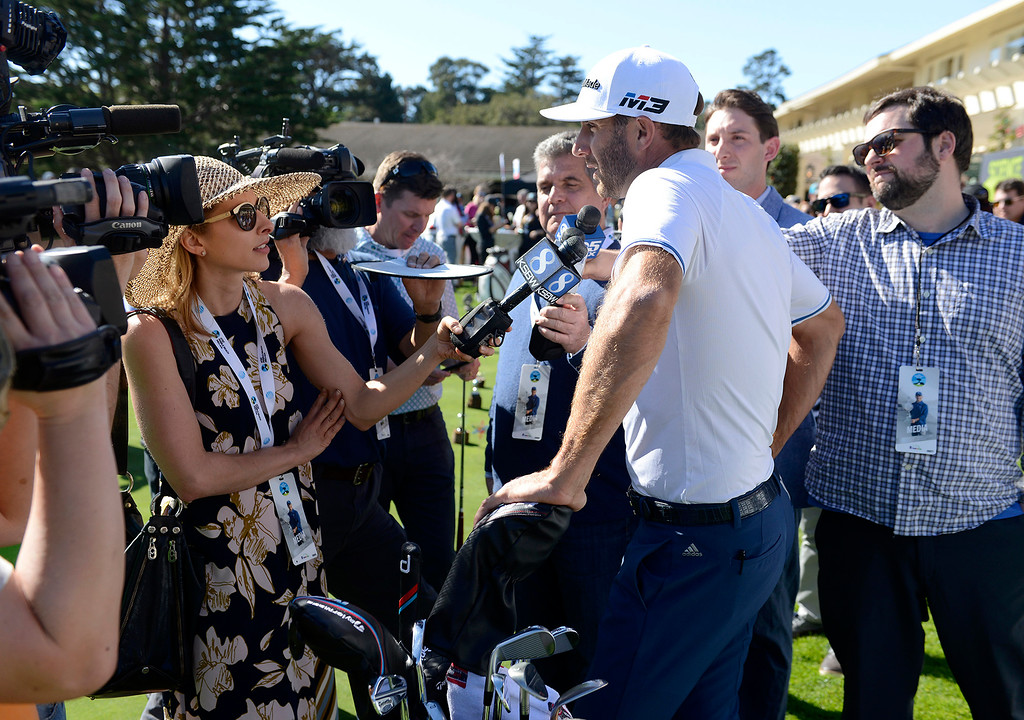 . Dustin Johnson being interviewed by the media prior to the Chevron Shoot-Out at the Pebble Beach Golf Links practice green on Tuesday, Feb. 6, 2018.  The Chevron Shoot-Out is a two-person teams that faced off in a five-hole putting challenge for charity. Teams were made by pairing past tournament champions with champions from other sports.  (Vern Fisher - Monterey Herald)