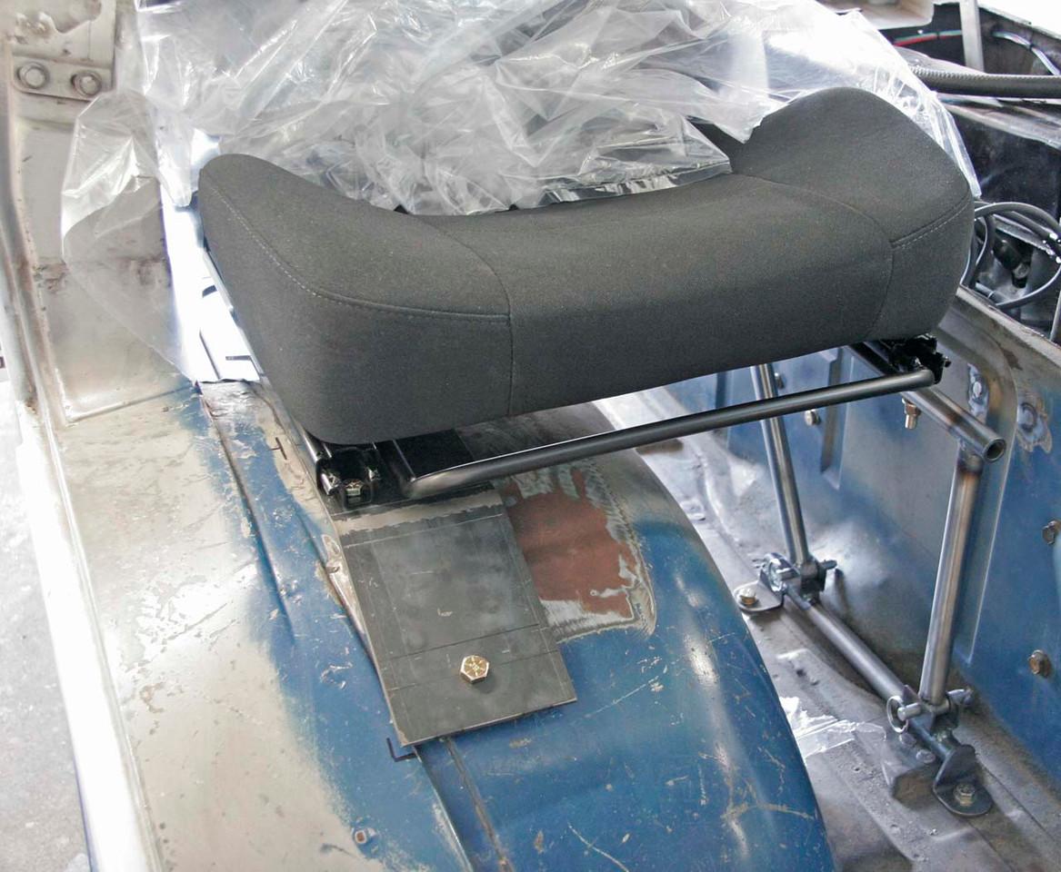 Passenger side seat mount. Fabrication by Defined Engineering, Yorba Linda CA.