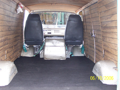 Paneling was there when I got it. Added carpet over exsisting plywood floor.