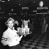 Lisa Molligi of Lowell serving drinks.