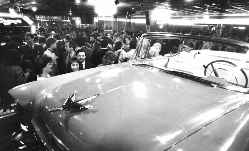 Crowd photo with Chevy Bel Air in the foreground.