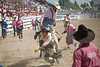 Bull Fighter Going for a Ride - Cheyenne Frontier Days Rodeo - Photo by Pat Bonish