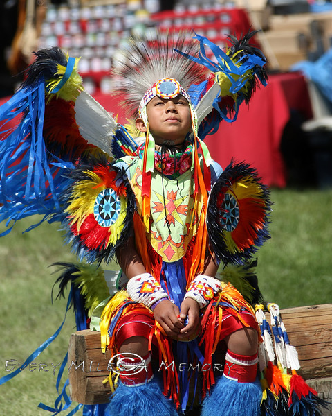 Young Warrior Sitting in the Afternoon Sun - Cheyenne Frontier Days Rodeo - Photo by Cindy Bonish