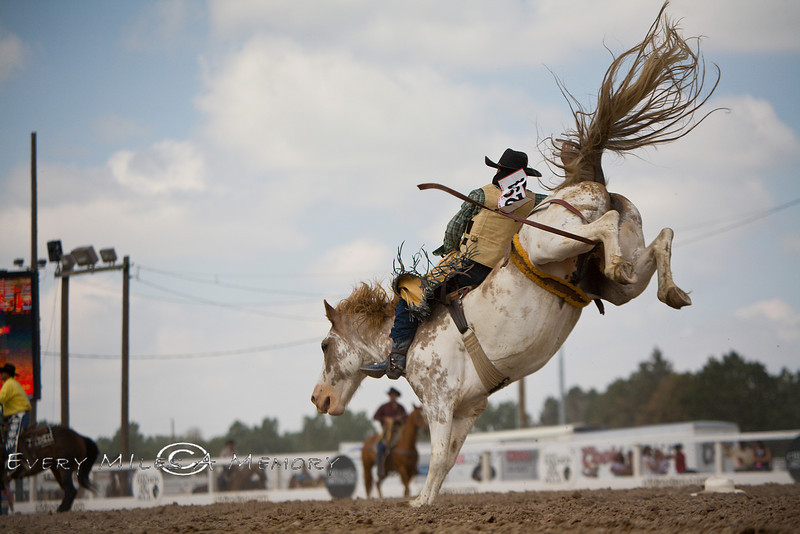 IMAGE: https://photos.smugmug.com/Cheyenne-Frontier-Days/Saddle-Bronc-Bareback-Riders/i-hq36NXw/1/L/Cody%20DeMers%20coming%20in%20for%20a%20Landing%20at%20the%20Cheyenne%20Frontier%20Days%20Rodeo%20in%20Wyoming%20-%20Photo%20by%20Pat%20Bonish-L.jpg