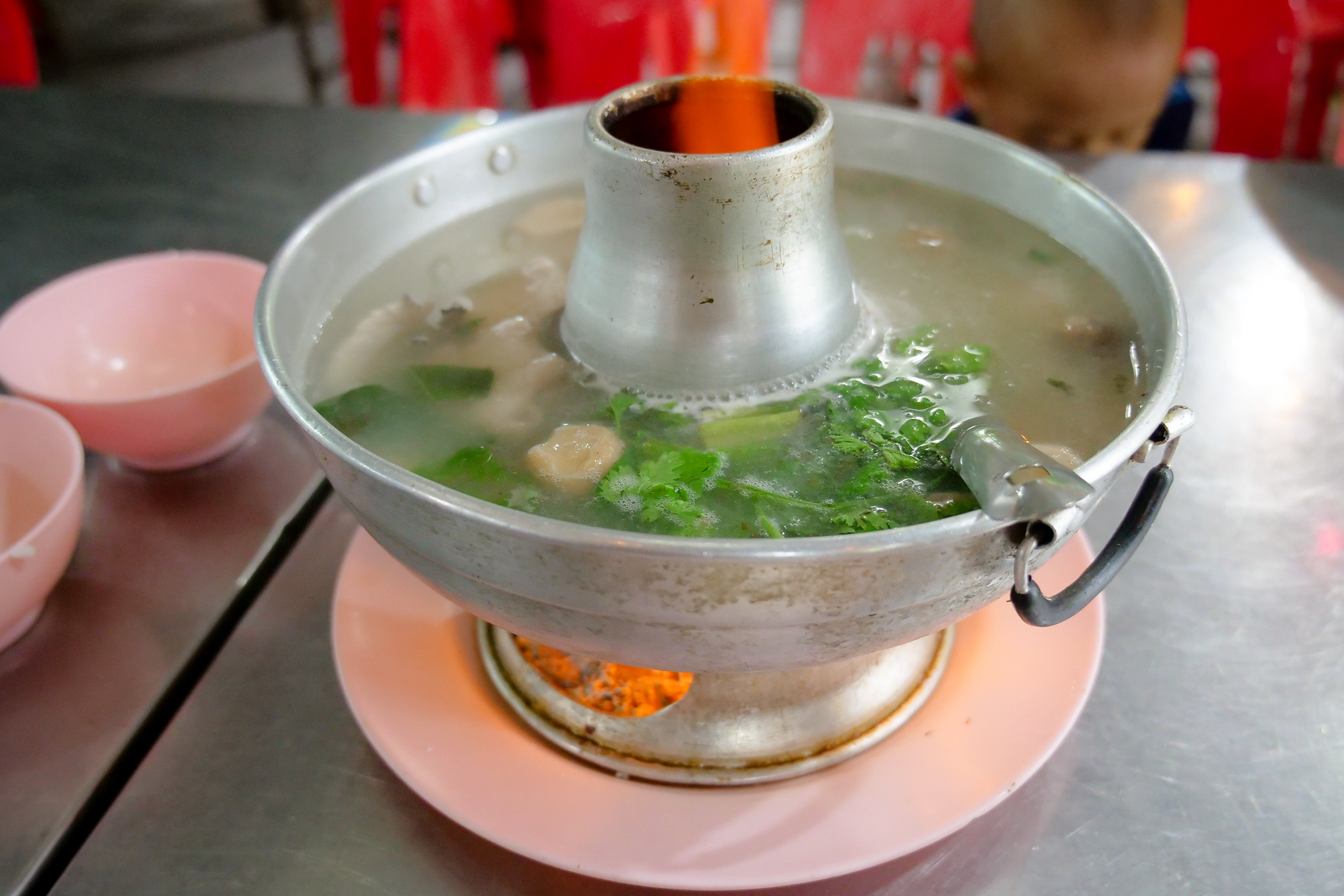 clear sour soup broth in a fire-pot at Lerd-Rote