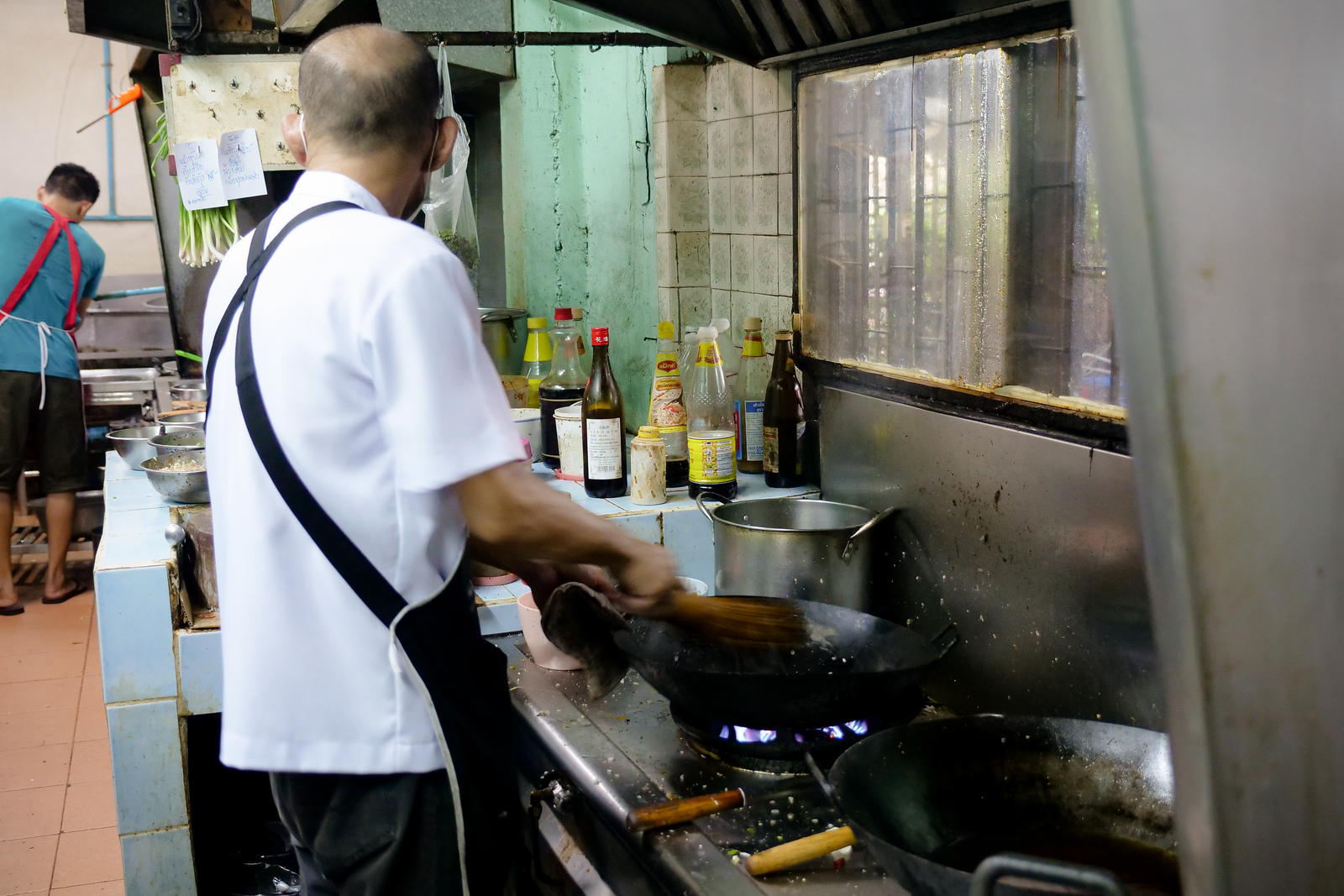 The wok-master at Lerd Rote, bathing in a pillar of steam
