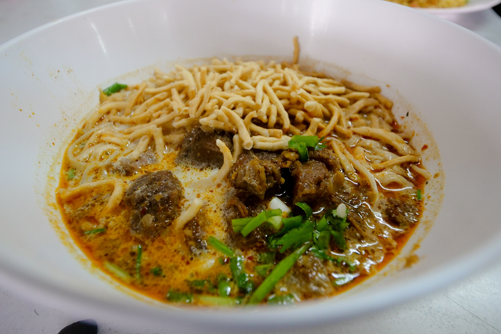 I love the noodles here, and the style is so different than other Chiang Mai Khao Soi Noodle restaurants