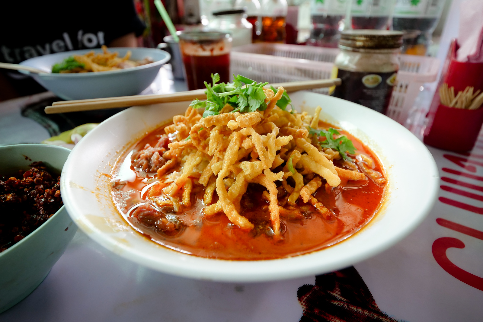 Loong Prakit's Khao Soi is just quite a looker, almost seductive with its deliciously red glistening and oily curry broth