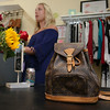 Ashley Lyons, owner of Chic Boutique in Tyngsboro, talked about her store on Monday and how she is trying to market to millennials for there back-to-school consignment shopping. Lyons showed off this Louis Vuitton bag she had for sale. SUN/JOHN LOVE