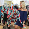 Ashley Lyons, owner of Chic Boutique in Tyngsboro, talked about her store on Monday and how she is trying to market to millennials for there back-to-school consignment shopping. Her she talks about a kimono that she has for sale that was made famous after it was worn by Emily Maynard on the Bachelorette. SUN/JOHN LOVE