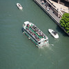 Chicago River aerial with tour boat and recreational boats traffic riverwalk