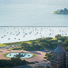 Aerial view including Buckingham Fountain, Lake Shore Drive, Monroe Harbor, and Museum Campus