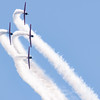Stunt planes make tight curve in formation at Chicago Air and Water Show