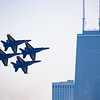 Blue Angels fly in front of John Hancock building at Chicago Air and Water Show