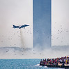 Harrier Jump Jet hovers in front of crowd at Chicago Air and Water Show, sending seagulls flying