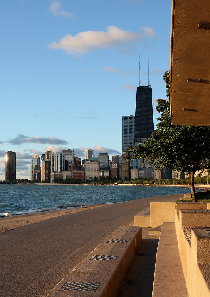 The John Hancock building and east Oak Street buildings in the distance, taken just after sunrise from the North Avenue Beach public chess benches.
