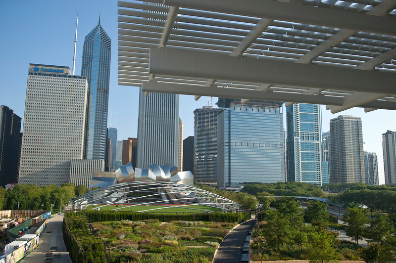 """The """"flying carpet"""" of Renzo Piano's Modern Wing of the Art Institute of Chicago cantilevers toward Chicago's Millennium Park with the Lurie Garden and Frank Gehry's Pritzker Pavilion."""