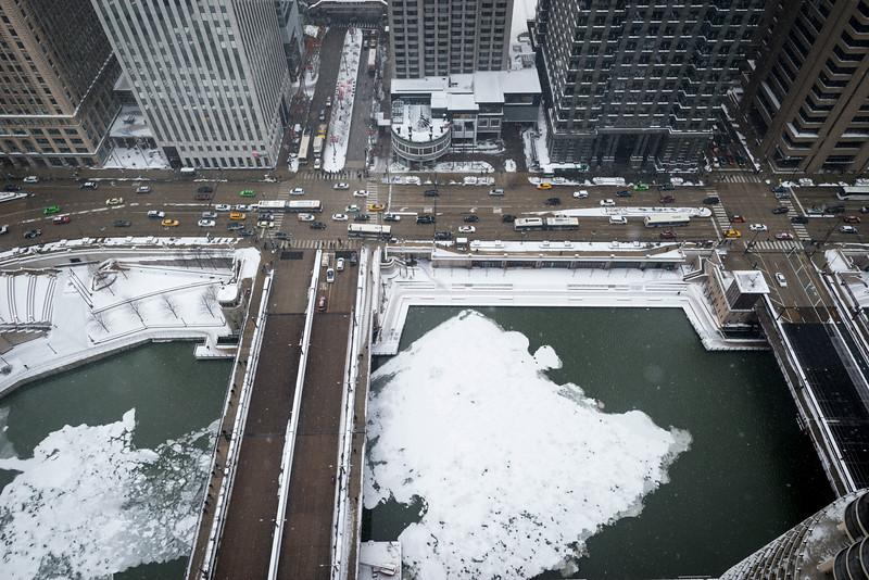 Aerial cold weather frozen Chicago River ice riverwalk snow