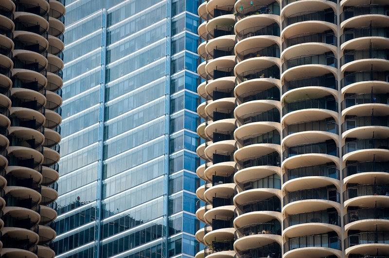 Detail of the concrete Marina City and steel and glass 353 North Clark Street buildings.