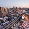 Uptown neighborhood aerial with CTA Red line Purple Line tracks and North Broadway winter dusk sunset