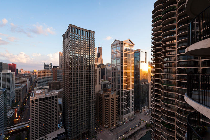 Sunset skyline view of The Loop central business district Leo Burnett Building and 77 E. Wacker Drive from Marina City Marina Towers architecture