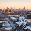 Skyline aerial from Uptown neighborhood with CTA Red line Purple Line tracks and CTA Wilson Station winter dusk sunset