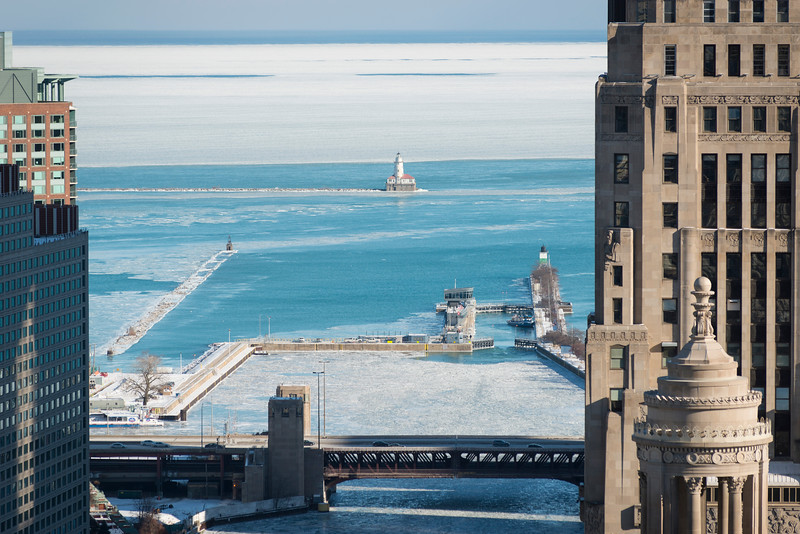Source of Chicago River lock Lake Michigan winter ice Chicago Harbor Lighthouse Lake Shore Drive bridge