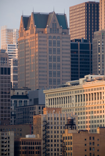 View of Chicago architecture with the gable roof of post-modern 190 S. LaSalle building.