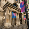 Chicago Cultural Center Randolph Street entrance facade with Chicago Architecture Biennial CAB banners signs