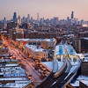 Skyline aerial from Uptown neighborhood with CTA Red line Purple Line tracks and CTA Wilson Station winter dusk sunset North Broadway