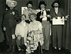A 1940s photo of Chicago Stake brethren doing a skit. Includes Floyd Grover, Bill Swinyard, others.