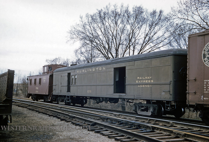 CB&Q 80 - Apr 2 1958 - Railway Express no 1075 & Caboose 14569 on freight @ Bevier MO - by Jim Ozment