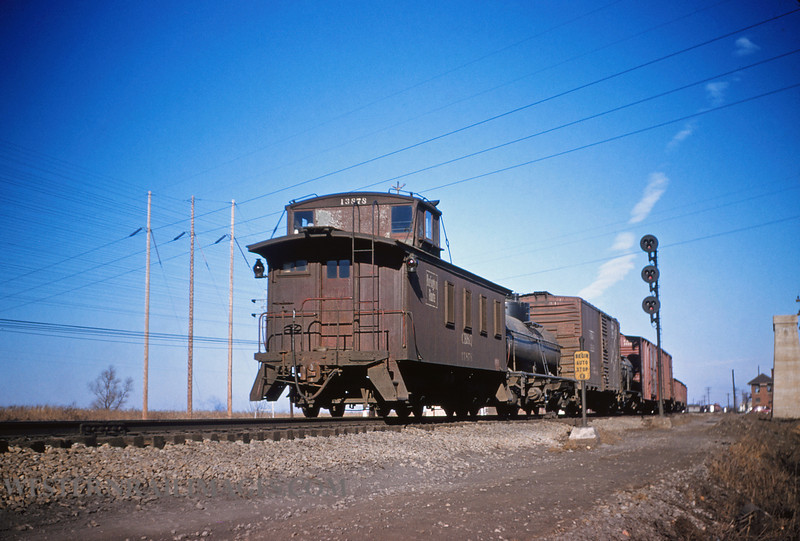 CB&Q 27 - Jan 3 1956 - Caboose 13878 on northbound freight @ Mitchell ILL - by Jim Ozment
