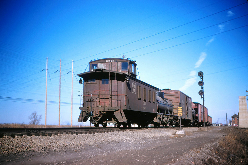 CB&Q 27 - Jan 3 1956 - Caboose 13878 on northbound freight Mitchell ILL