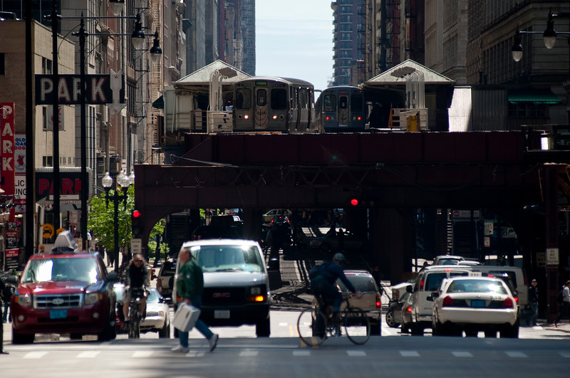 Elevated CTA trains move above Wabash Avenue in Chicago's Loop.