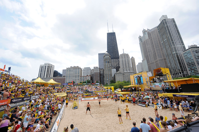 Fans of professional volleyball cheer on their favorite team during a tournament held at the North Avenue Beach.