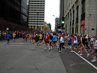 Mile 13, the turn from Franklin onto Adams, heading west. The crowd is packed with spectators several levels deep, and the cheering makes this one of the most enjoyable spots on the course.