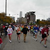 Past Greektown, heading south toward mile 19 and Chinatown. Runners are looking more serious.