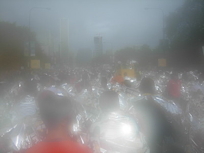 In a haze. What the finish area -- a sea of athletes in silver mylar -- might look like to some finishers?   (actually, it's just condensation on the lens)