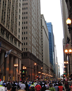 Among the towering banks on LaSalle Street, heading north and into mile 3.